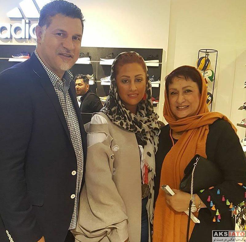 خانوادگی  علی دایی و همسرش در افتتاحیه فروشگاه جدیدش
