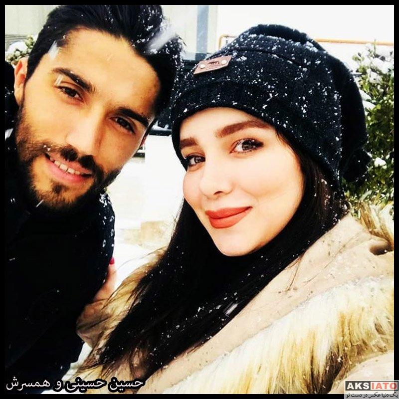 سید حسین حسینی و همسرش در روز برفی تهران (عکس)