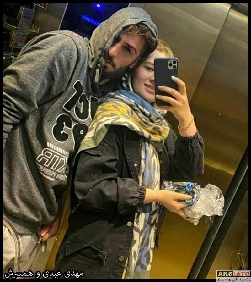 ورزشکاران ورزشکاران مرد  مهدی عبدی و همسرش الینا (3 عکس)
